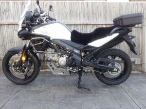 Suzuki DL650 V Strom 2004-2010 Black Sheepskin Motorcycle Seat Cover on White bike
