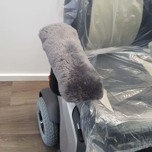 Grey Sheepskin Universal Armrest cover on Mobility Scooter Seat
