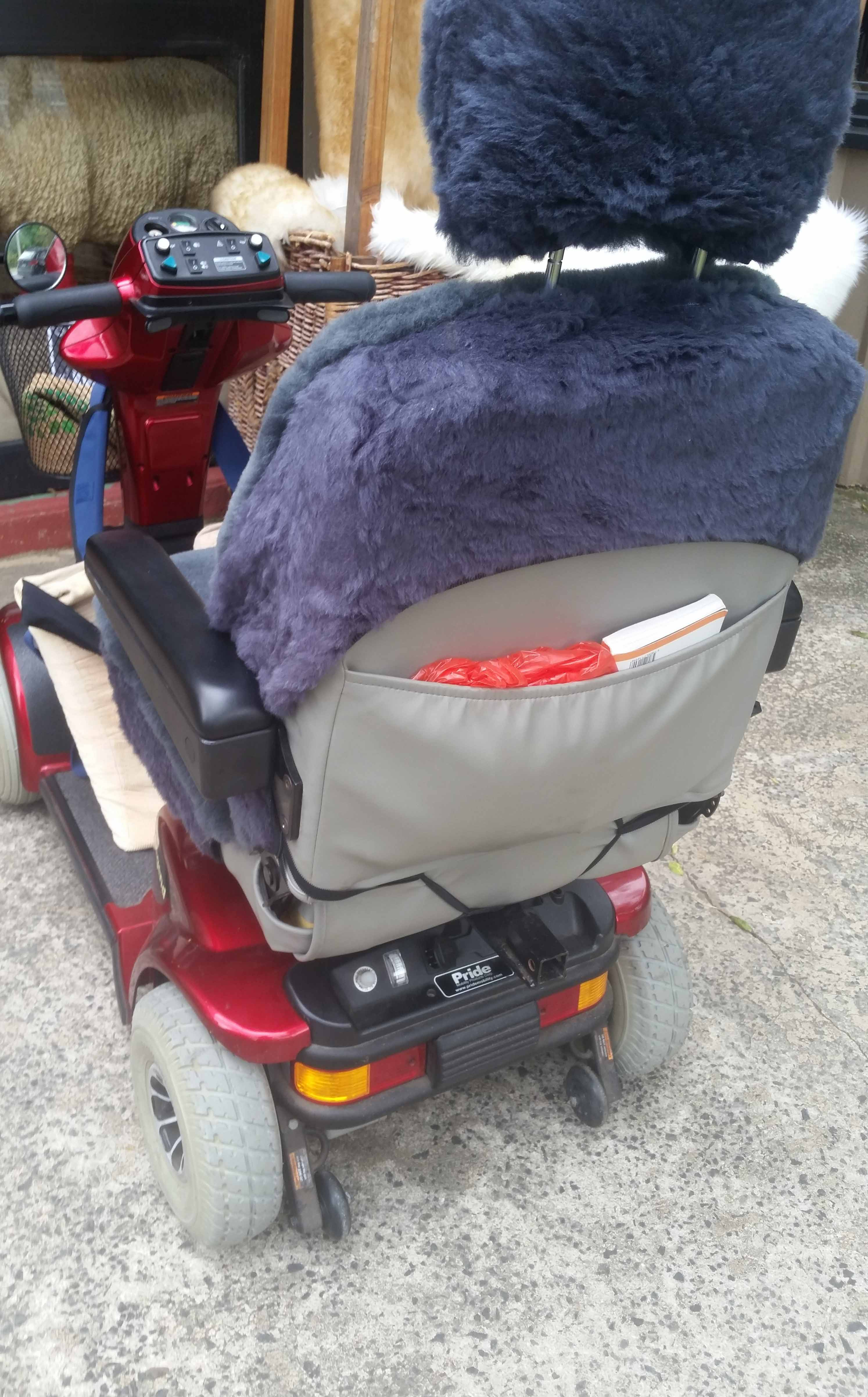 Charcoal Sheepskin and Acrylic Mobility Scooter Seat and Headrest Cover Showing map pocket details