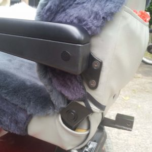 Charcoal Sheepskin and Acrylic Mobility Scooter Seat and Headrest Cover showing armrest and map pocket fitting